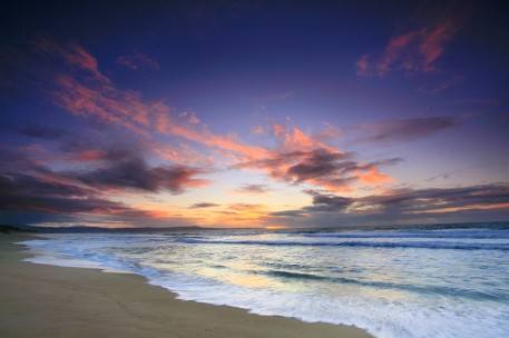 Beach and incoming waves at sunset in Monterey Bay
